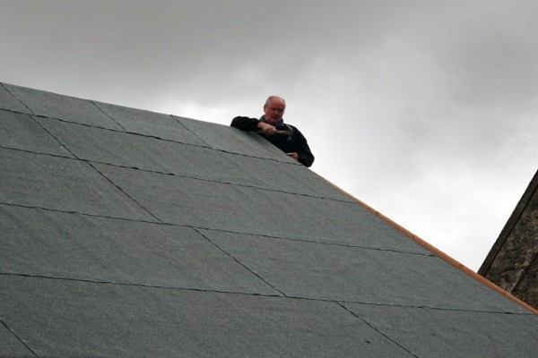 contractor installing a single-ply membrane roof
