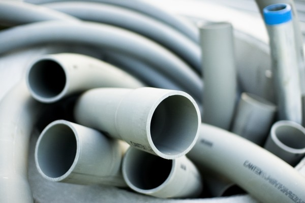 huge pvc pipes and tubes knotted together