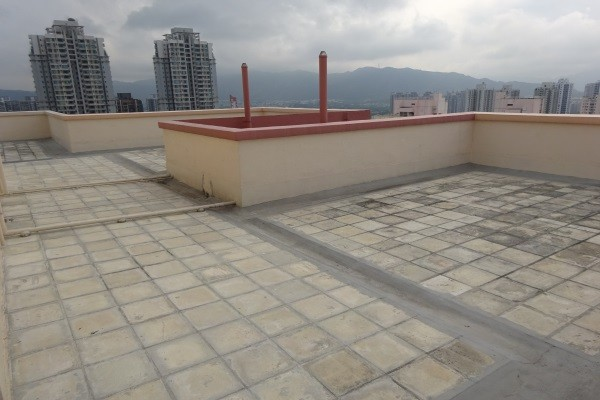 a concrete-tiled commercial flat roof