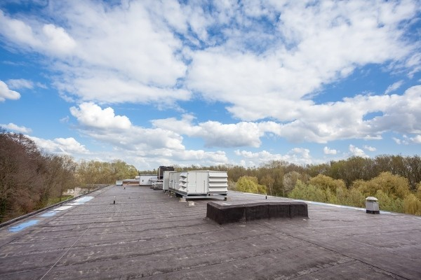 view of flat roof with equipment