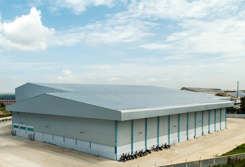 view of warehouse with metal roof in sunny day