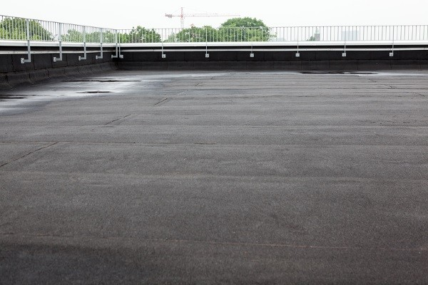 standing water on a flat-roofed commercial property