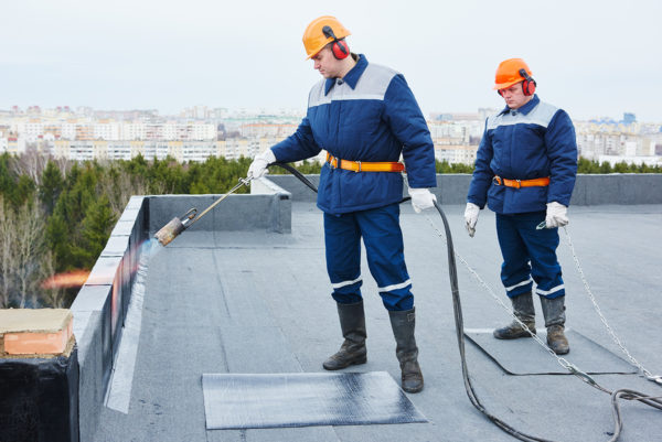 flat roofing installation using a blow torch